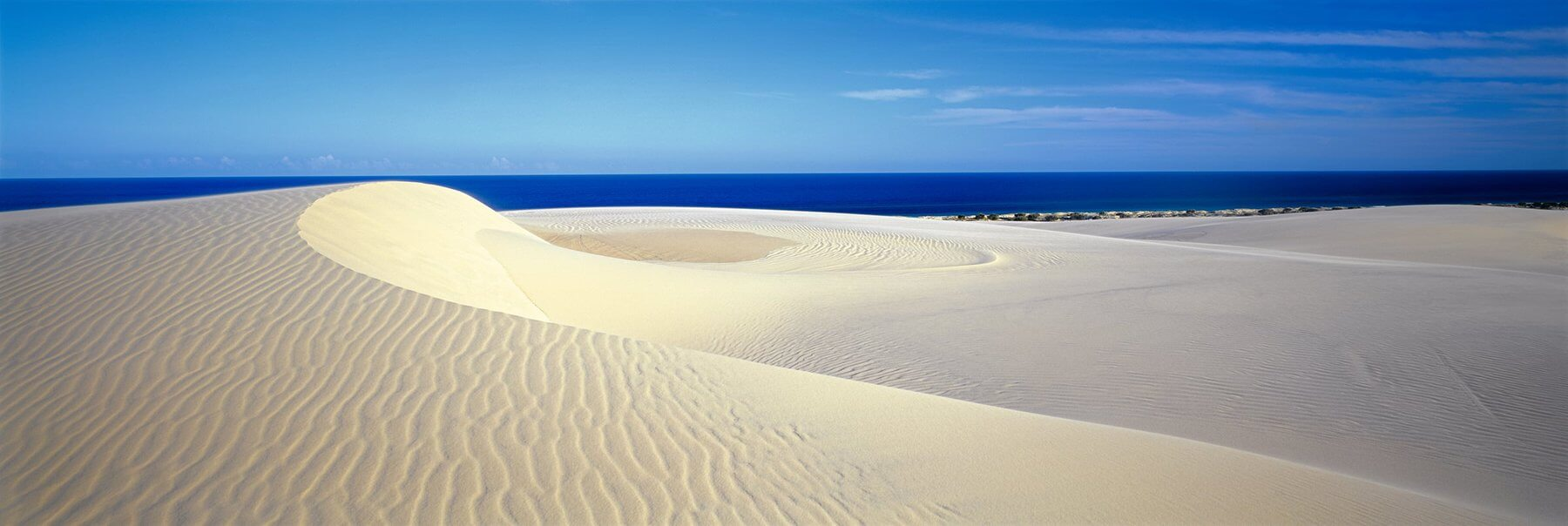 Why visit the sand dunes of Fraser Island?